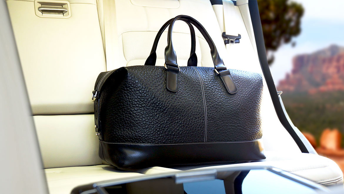 black leather travel bag by santoro